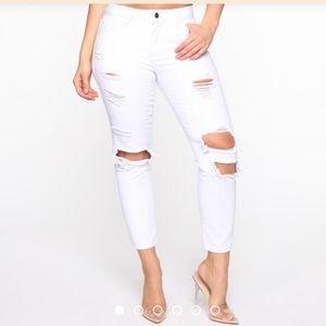 Distressed boyfriend jeans by Fashion Nova